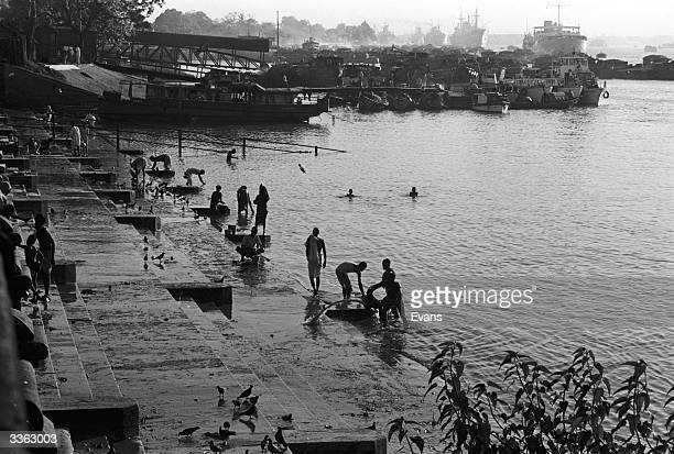 Ghats on the Hooghly River in Calcutta one of the branches of the Ganges Delta where people swim bathe and wash clothes
