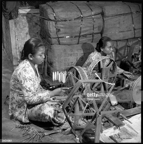 Indonesian textile workers winding bobbins in Java
