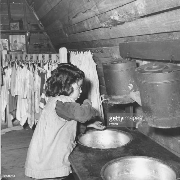 Joannina a young Greek schoolgirl washing her hands