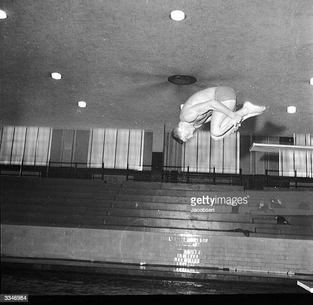 John Barricini one of New York University's star divers demonstrating a front somersault