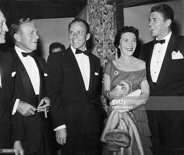 LR Actors Jack Benny George Burns Frank Sinatra Nancy Davis Reagan and her husband Ronald Reagan dressed in formal attire and smiling in the lobby of...
