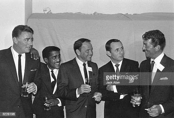 Members of the Rat Pack British actor Peter Lawford American actor singer and dancer Sammy Davis Jr actor and singer Frank Sinatra actor Joey Bishop...