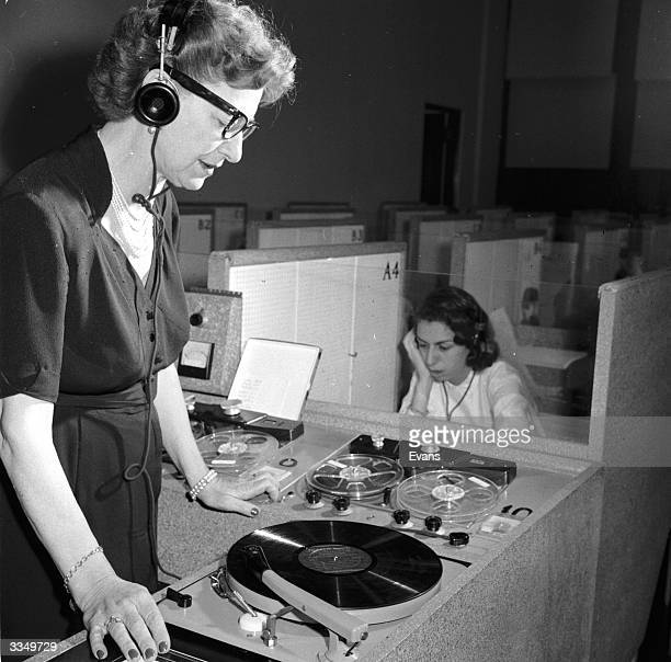Miss Pleasants director of Columbia University's Language Laboratory plays a record on the master turntable to be transmitted to the student's booths