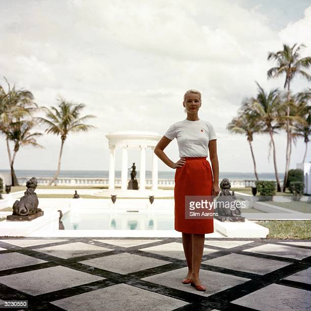 Mrs F C Winston Guest stands in front of the Grecian temple pool on her oceanfront estate Villa Artemis Palm Beach Florida