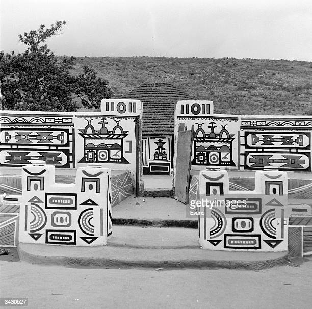 Ndebele women decorate their houses and compound walls with intricate and geometric patterns