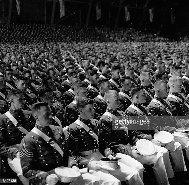 Over six hundred soldiers sit in the Field House of the US Military Academy West Point New York awaiting the words that will pronounce them graduated...