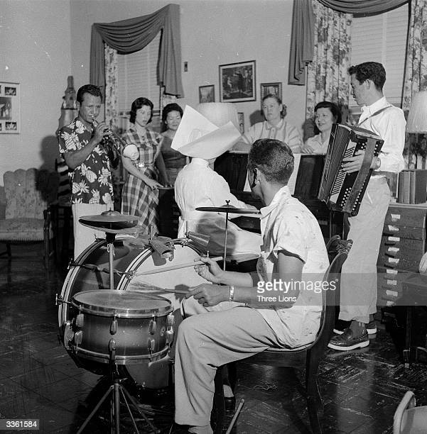 Patients at the US Public Health Service Hospital in Carville Louisiana enjoying a musical evening The hospital is for leprosy sufferers and is run...
