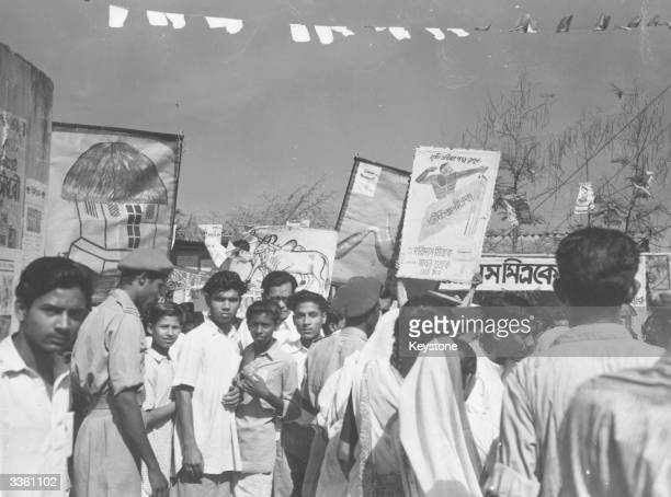 Placards and banners being carried by boys who are canvassing the Congressional and Socialist parties during the Indian general election