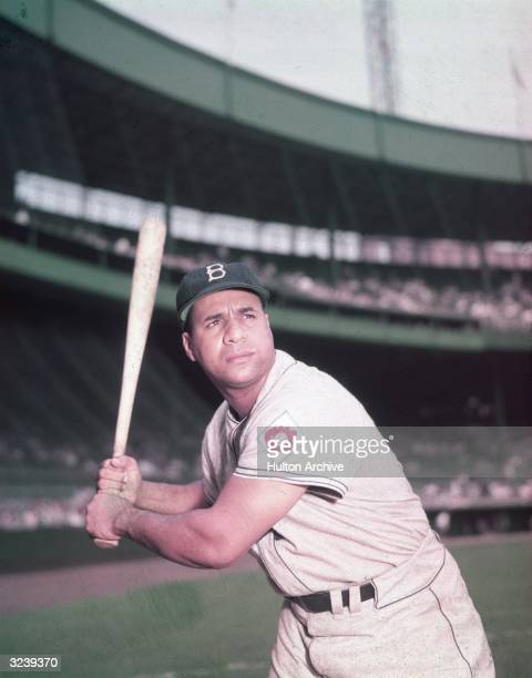 Portrait of baseball player Roy Campanella Brooklyn Dodgers catcher standing at bat in an empty stadium