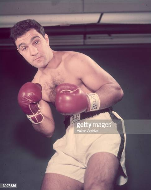 Portrait of boxer Rocky Marciano wearing boxing shorts and gloves posing in a fighting stance 1950s