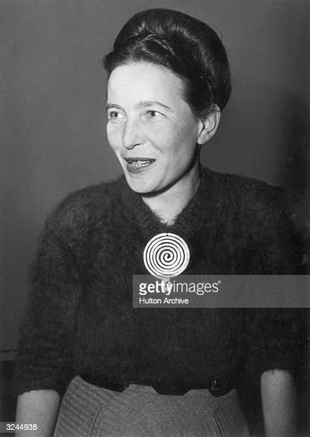 Portrait of French author and early feminist Simone de Beauvoir wearing a brooch designed by artist Alexander Calder