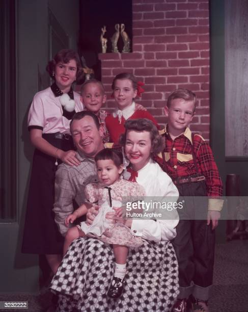 Portrait of married American actors and singers Roy Rogers and Dale Evans posing with their children Cheryl, Sandy, Linda Lou, 'Dusty' Roy Jr. And...