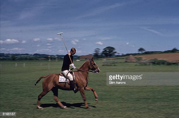 Prince Philip, Duke of Edinburgh on his polo pony at Cowdray Park, Sussex.
