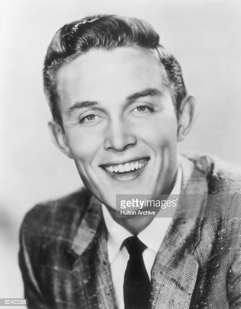 Promotional portrait of American country singer and actor Jimmy Dean laughing for the American television series 'The Jimmy Dean Show' He is wearing...