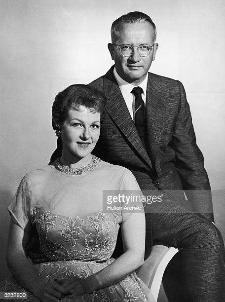 Promotional portrait of American jazz and pop vocalist Jo Stafford and her husband, the American conductor and arranger Paul Weston , sitting...