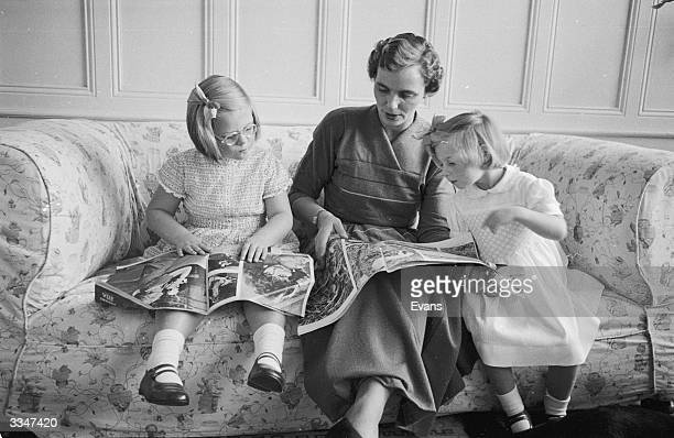 Queen Anne of Romania sitting with her two daughters after their exile
