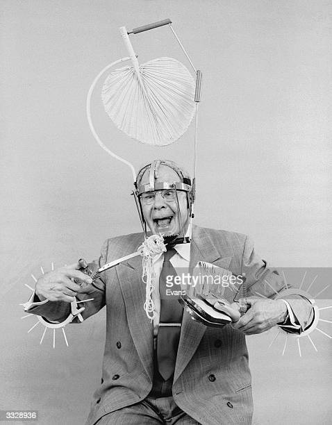 Russell E Oakes an amateur American inventor wearing his problem solving inventions Spikes around his arms which enable him to weave through busy...