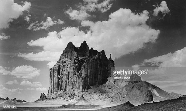 Shiprock in the plains of New Mexico's Navajo Native American country Rising to 1640 feet Shiprock is sacred to the Navajos and its summit was not...