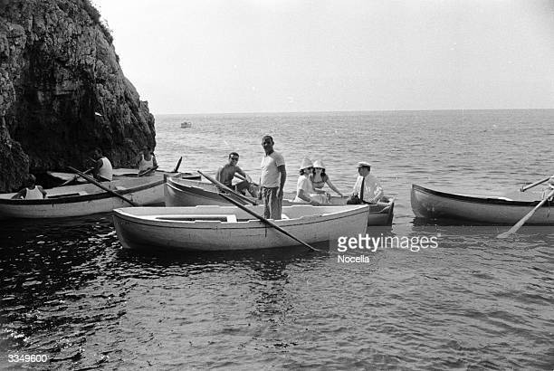 Sight-seeing boats queue up for entry to the Isle of Capri's famous 'Grotta Azzurra' or Blue Grotto.