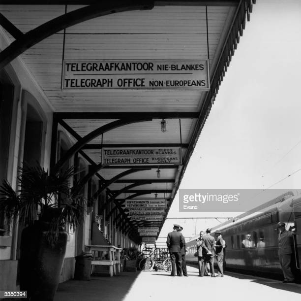 Signs in English and Afrikaans in Wellington railway station South Africa enforcing the policy of apartheid or racial segregation