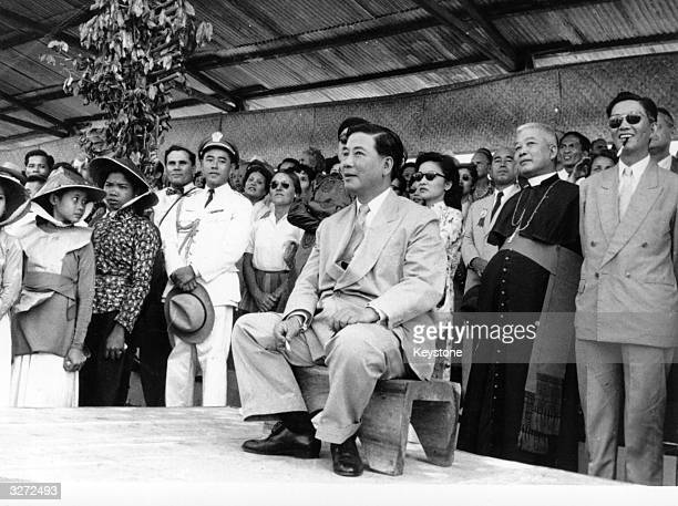 South Vietnam President Ngo Dinh Diem watching an agricultural show just minutes after an assassination attempt had been made on his life