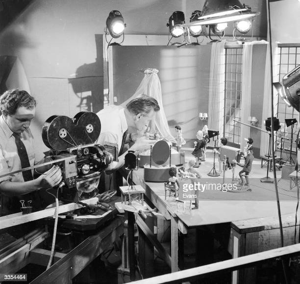 Studio technicians and cameramen prepare to shoot the next in a sequence of stopmotion frames using a cast of dolls at Dollywood the Dutch centre of...