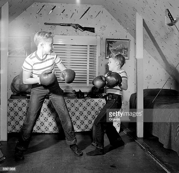Television stars Ronnie and Glenn Walken boxing in the attic of their home in Bayside Long Island