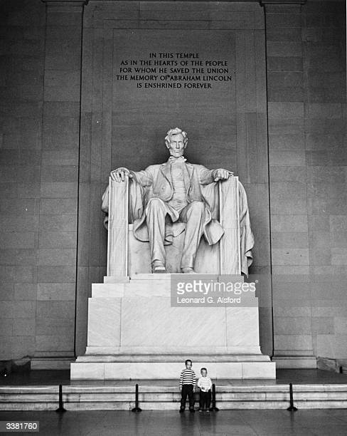 The 19 foot high white marble statue of Abraham Lincoln by Daniel French which resides in the Lincoln Memorial building in Potomac Park Washington DC