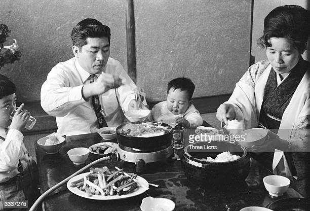 The Asai family enjoying their evening meal together at their home in Hiroshima