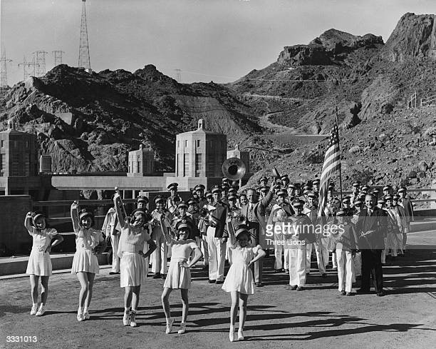 The boulder City School Band and majorettes is the first band ever to cross the Boulder Dam one of the largest dams in the USA