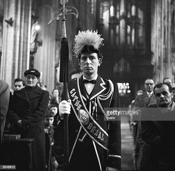 The 'Keeper of the Cathedral resplendant in his costume leads the traditional procession of 'Our Lady of Den Bosch' at the cathedral in the Dutch...