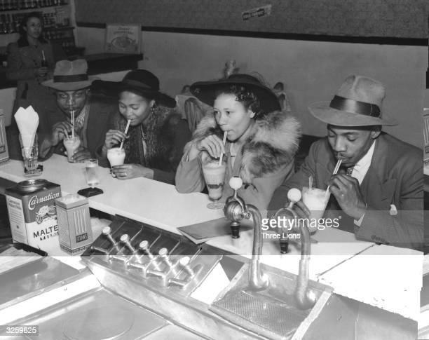 The Mayweather family enjoying an icecream soda at a milk bar