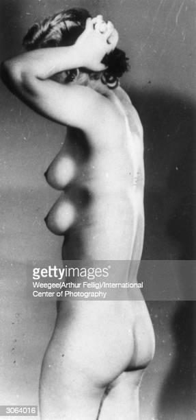 Trick photography showing profile of a nude woman with two breasts one above the other Photo by Weegee/International Center of Photography/Getty...