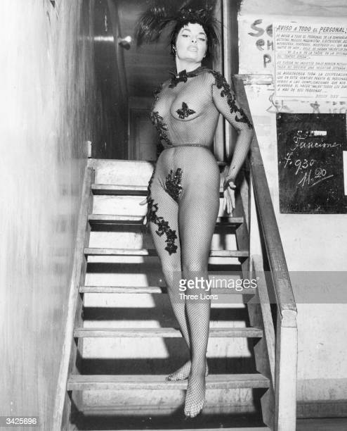 Wearing an outfit made of mesh a striptease artiste stands on the dressingroom stairs of the Opera House in Santiago Chile