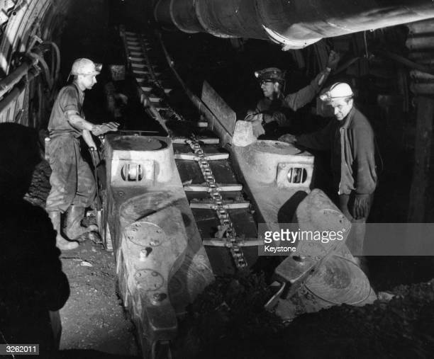 Welsh and Germans work together on a conveyer belt at this Welsh anthracite mine