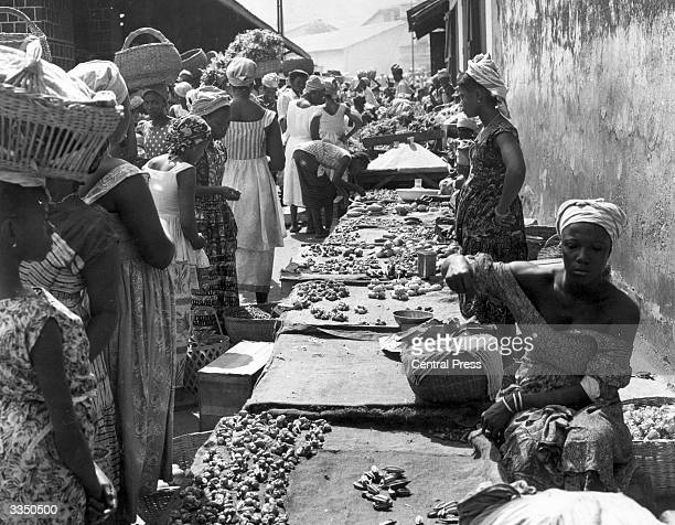 Women buying and selling food along the Central Market Avenue Freetown Sierra Leone