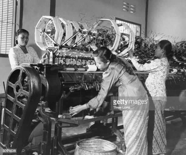 Women work at spinning machine in Indonesia