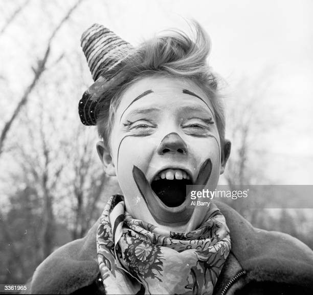 Young clown Ronnie Walken later film star Christopher Walken pulls a face for the camera