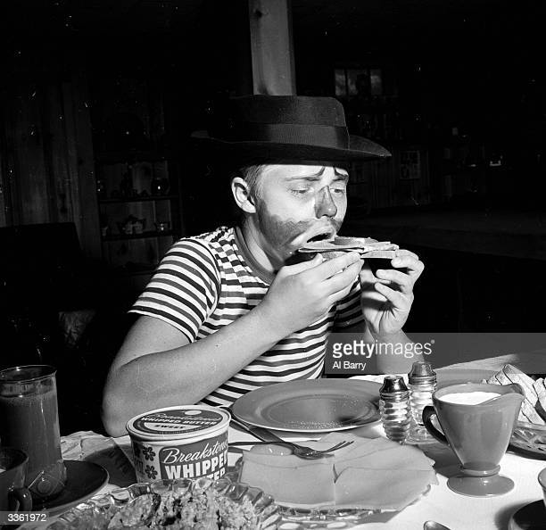 Young clown Ronnie Walken later film star Christopher Walken eating a sandwich