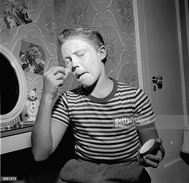 Young clown Ronnie Walken later film star Christopher Walken applying white foundation as a base for his greasepaint makeup