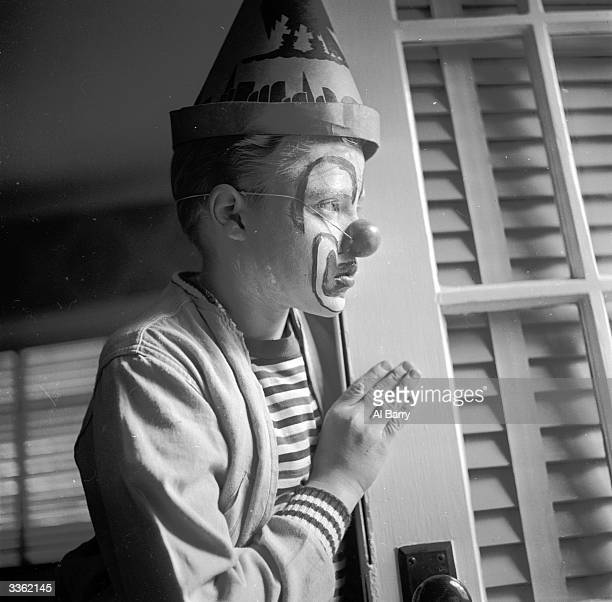 Young clown Ronnie Walken later film star Christopher Walken looking out onto the street