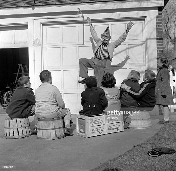 Young clown Ronnie Walken later film star Christopher Walken performing for an audience of young neighbours