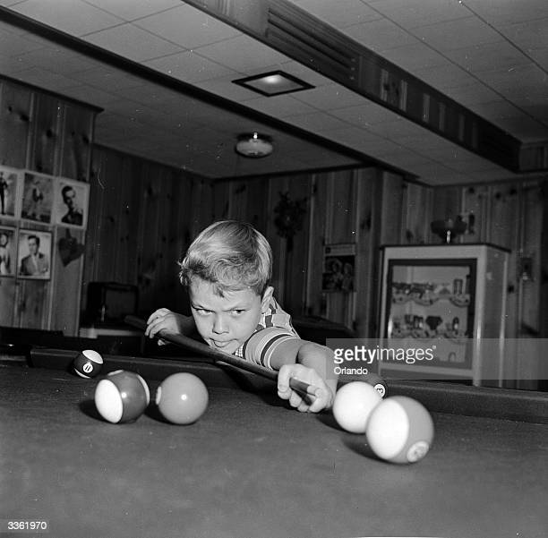 Young television star Glenn Walken cues up a shot during a game of pool at home in Bayside Long Island