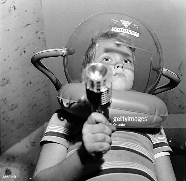 Young television star Glenn Walken dressed up in a space helmet at home in Bayside Long Island