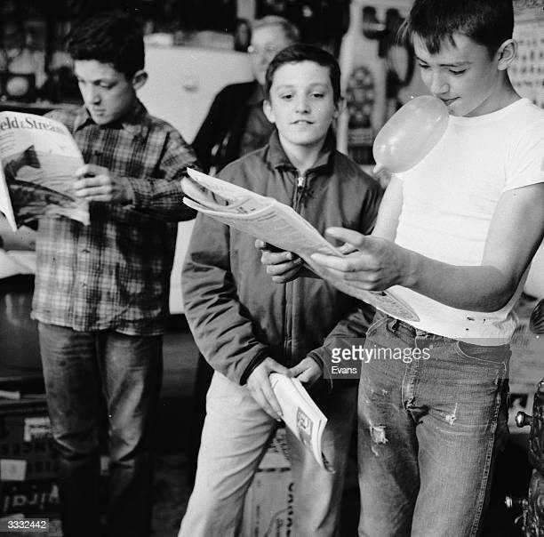Youngsters at Lester Sykes' general store in Brownsville, Vermont, manage to treat the magazine rack as a library, all for the price of some candy or...