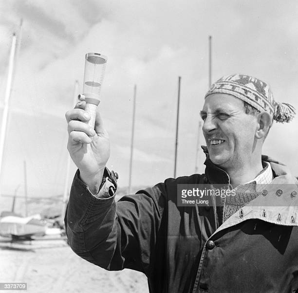 A member of the Lytham St Anne's sand yachting club in Lancashire tests the wind speed with an anemometer Ideal wind speeds for sand yachting range...