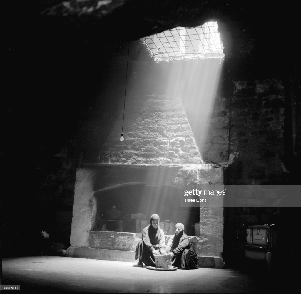 Introduction to the three lions collection photos and images getty a shaft of light falls on two nuns in the kitchen of the mar taqla in workwithnaturefo