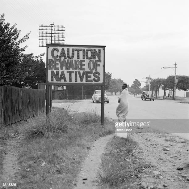 A sign common in Johannesburg South Africa reading 'Caution Beware Of Natives'