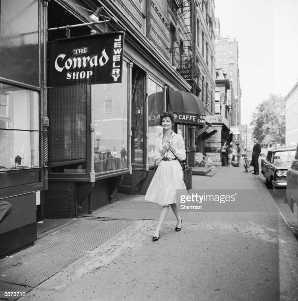 A tourist on a walking tour of New York visits the shops and cafes of Greenwich Village
