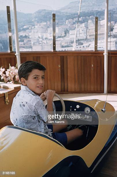 Alexander Onassis son of the Greek shipping tycoon Aristotle driving a toy car on board the family's luxury yacht 'Christina' in Monte Carlo